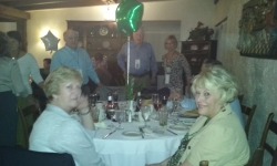 Judy (Shumaker) Devey & Lorraine at banquet table